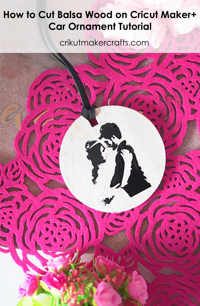 DIY Circular Car ornament with a couple silhouette vinyl decal made from Cricut and balsa wood.