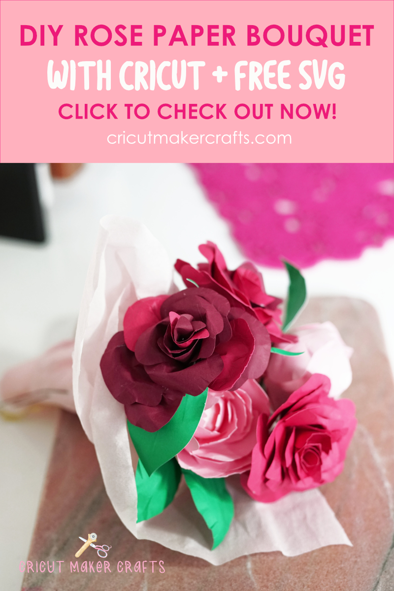 Rose paper flower bouquet with two red paper roses wrapped in pink crepe paper.