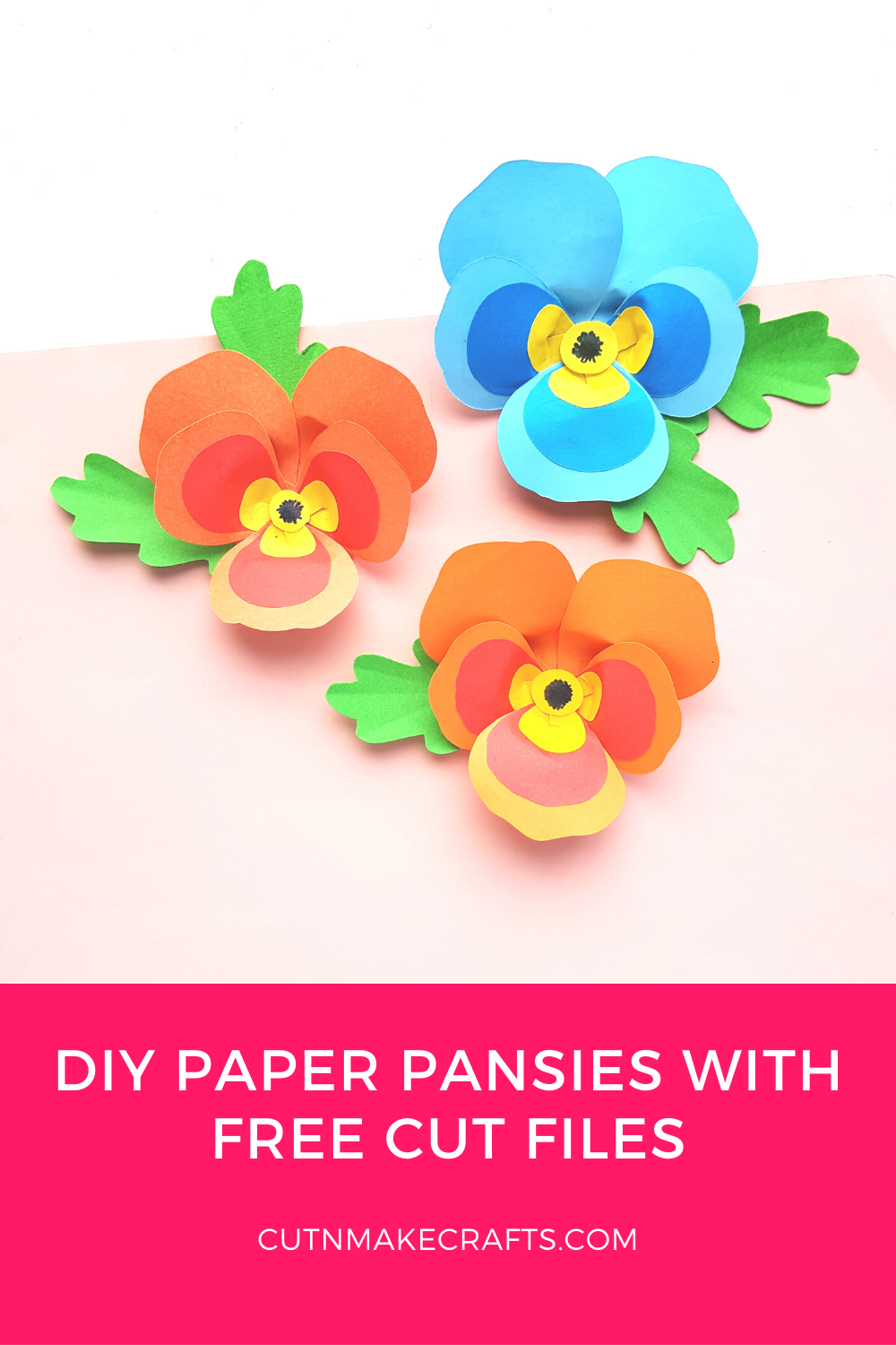 3 paper pansies in blue red and orange